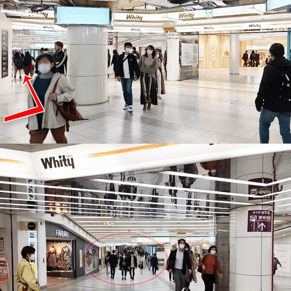 5.「Whityうめだ」の看板が上に見えましたら、壁に沿って左へ直進し、しばらく直進します。